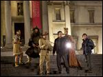 from left, Mizuo Peck, Patrick Gallagher, Robin Williams, Ben Stiller, Rami Malek and Skyler  Gisondo in a scene from 'Night at the Museum: Secret of the Tomb.'