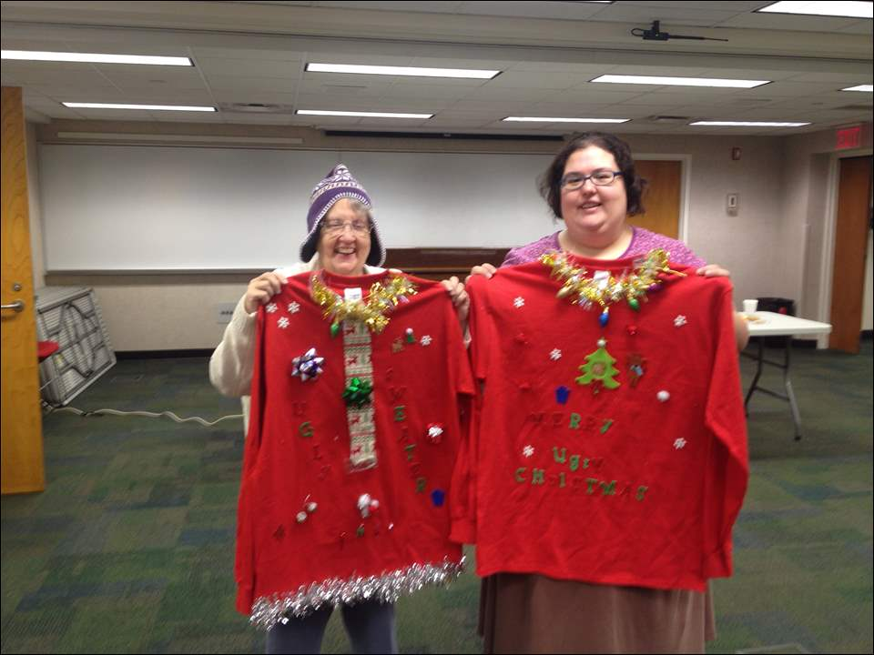 Linda Fryman (left) and Danara Fryman (right) show off their sweaters.
