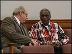 Attorney Mark Geudtner, left, and his client Charles 'Slim' Lake, Sr. in Lucas County Common Pleas court on Dec. 8.