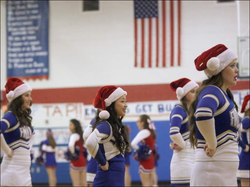 Findlay's cheerleaders sport Santa Claus hats before the start of game Tuesday.
