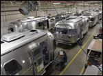 Not only are the Airstream trailers still being built by hand at the same western Ohio site that has produced them for the past 60 years, but the company also can't roll them out of there fast enough to meet the demand these days.