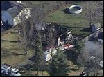 This aerial photo taken from video provided by WCMH-TV shows a burned out home in Washington Court House, Ohio today.