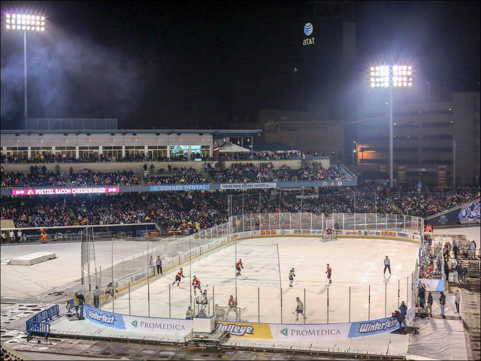 The Walleye play Kalamazoo during the first outdoor hockey game in ECHL history. Kalamazoo defeated Toledo 2-1.