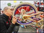 Dan Ersley, left, with BikeSource Dublin and Jordan Starrett, 9, repair a bike at Daniel Wright Elementary School in Dublin, Ohio, as part of a program that started last month.