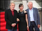 French actress Marion Cotillard, center, and directors Jean-Pierre Dardenne, left, and Luc Dardenne arrive for the screening of 'Two Days, One Night' at Somerset House in central London.