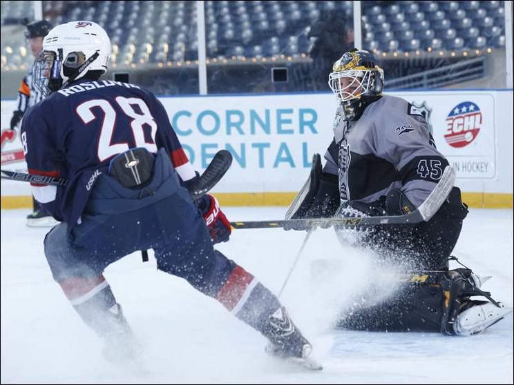 Adrian College's Dillon Kelley protects the goal against USA Hockey U18's Jack Roslovic.