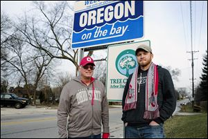Dick Squibb, left, and his son, Matt Squibb, are among the people calling for the City of Oregon to change its name in support of Ohio State, which will play the Oregon Ducks in college football's championship game on Jan. 12.