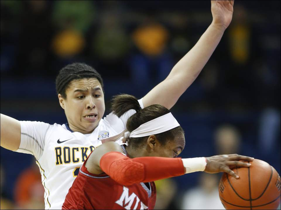 University of Toledo basketball player Jay-Ann Bravo-Harriott (11) defends Miami University player Baleigh Reid (24) during the first half at Savage Arena, Saturday, January 3,  2015.