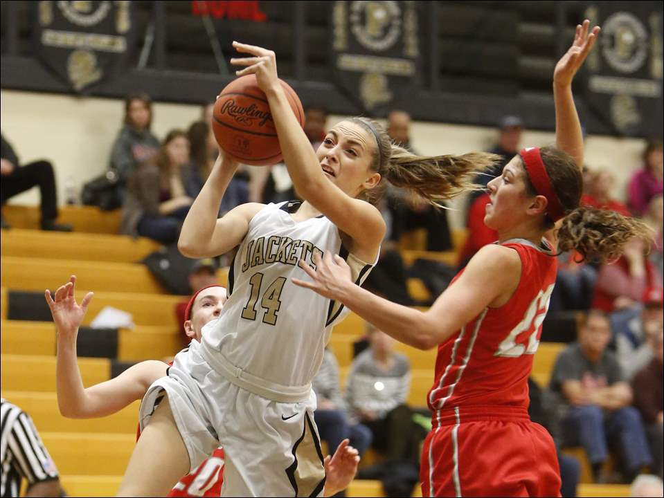 Perrysburg High School player Macy Tudor shoots against Central Catholic basketball player Byrdy Galernik (22).