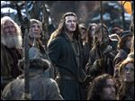 This photo provided by Warner Bros. Entertainment shows Luke Evans, center, as Bard in the fantasy adventure
