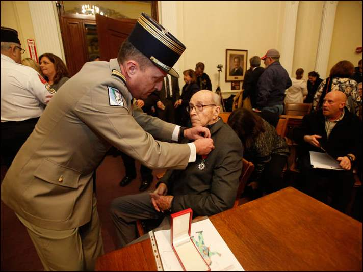 French Colonel Nicolas Auboin, left, pins the French Legion of Honor onto Fifth Congressional District of Ohio resident and World War II veteran, Clyde Shull, left.