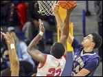 Kaleb Vaughn of St. John's blocks a shot against  St. Francis' Dontay Ellison during Monday night's game at Savage Arena. The Titans are 7-2.