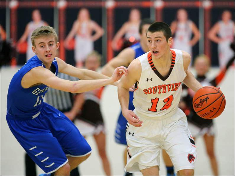 Sylvania Southview's Matt Schafer (12) drives past Anthony Wayne's Jake Mruzek (11).