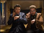 This photo released by Sony - Columbia Pictures shows James Franco, left, as Dave and Seth Rogen as Aaron in a scene from Columbia Pictures'