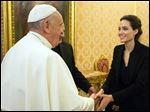 Pope Francis meets Angelina Jolie during a private audience at the Vatican, today.