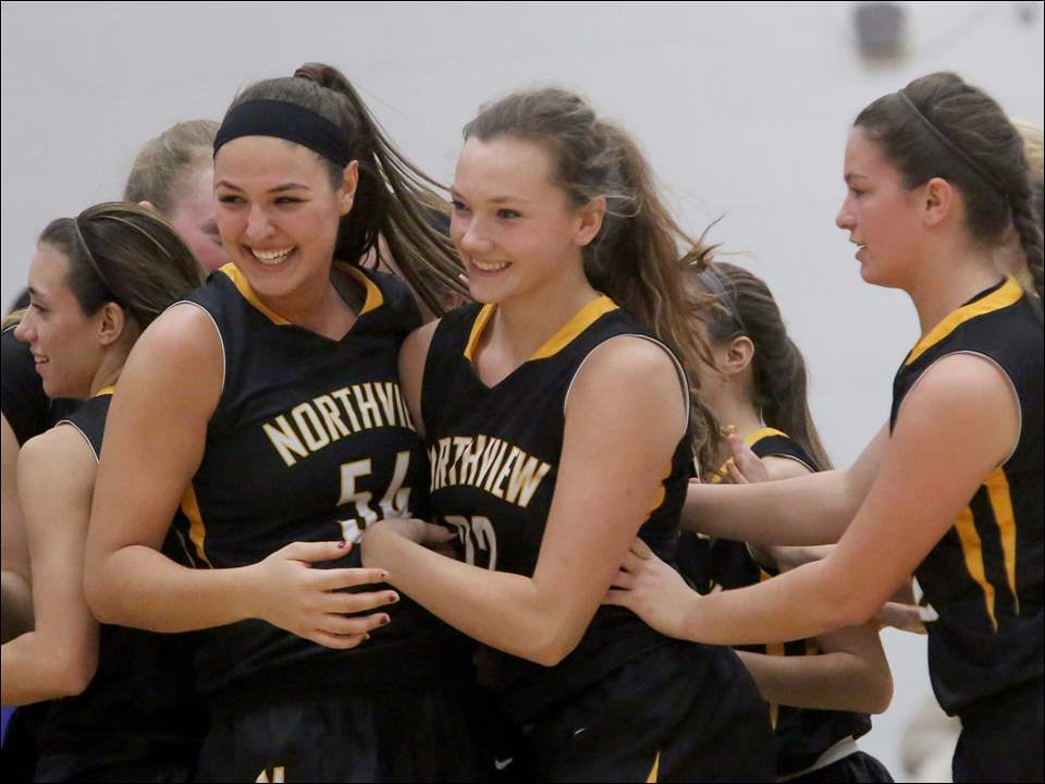 Northview's Kendall Jessing, left, and Katie Cole, center, celebrate their win.