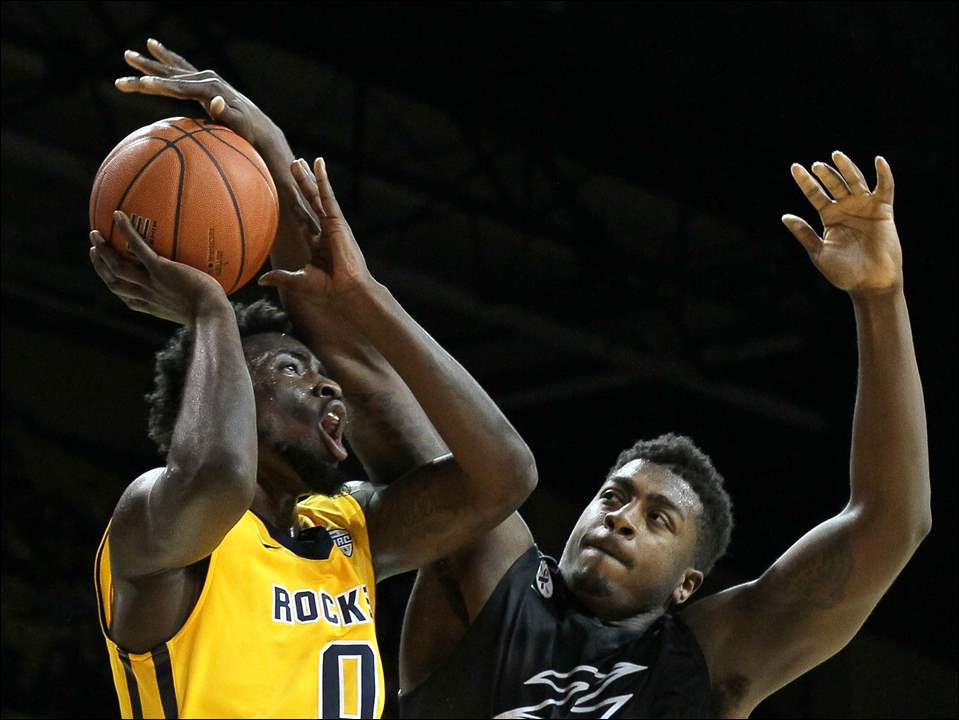 University of Toledo guard Kurt Hall (0) shoots against Akron center Isaiah Johnson (23).