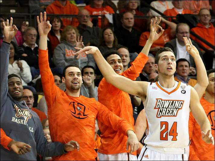 Bowling Green's bench goes wild as Mat Fox (24) sinks a three point field goal.