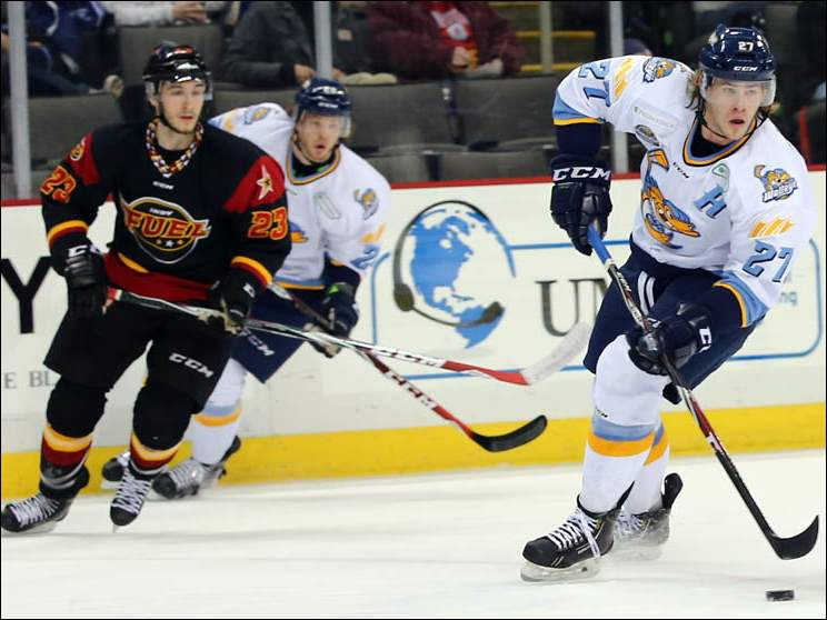 Walleye's A.J. Jenks (27) moves the puck against  Indy's Dillon Fournier (23).