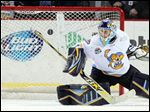 Walleye goalie Jeff Lerg (1) defends the net against Indy.