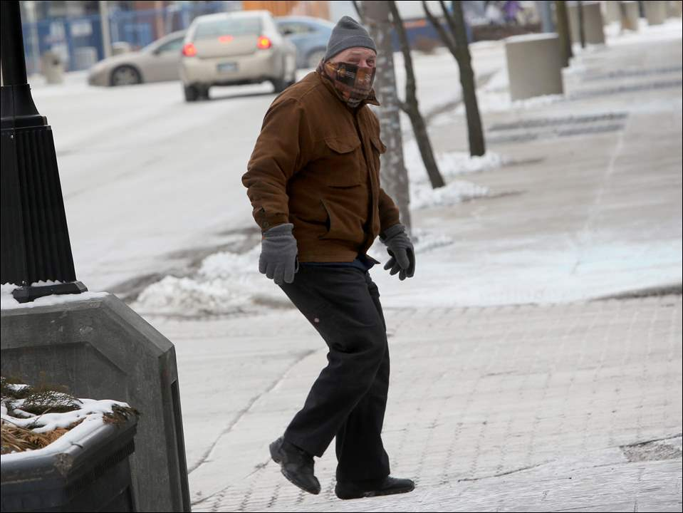 """I'll tell you what,"" downtown Toledo resident Garry Cline said, ""my heart goes out to the homeless in this weather."" Mr. Cline's eyelashes had frozen as he braved the cold."