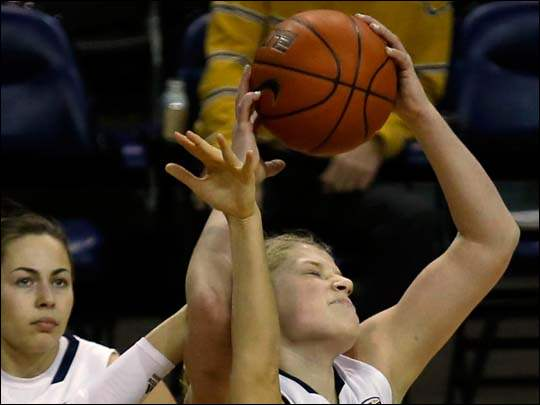 Toledo's Sophie Reecher pulls a rebound from Akron's Sina King.