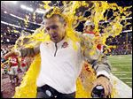 Ohio State coach Urban Meyer has Gatorade dumped on him as the team begins celebrating its win over Oregon for the national title at AT&T Stadium in Arlington, Texas.