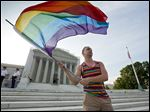 A same-sex marriage supporter stands in front of the U.S. Supreme Court. The court will hear arguments to decide whether states can legally ban same-sex marriage.
