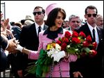 Katie Holmes again will portray Jacqueline Kennedy in an upcoming Reelz miniseries titled The Kennedys After Camelot.