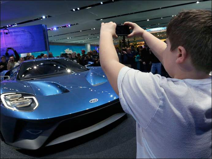 Bailey Jackson, 10, of Sarnia, Ontario Canada, takes a photo of the Ford GT.