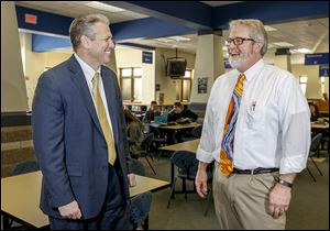 Perrysburg Schools Superintendent Thomas Hosler, left, chats with high school principal Michael Short at Perrysburg High School. 'We value our staff and what they do and we try to show that, although we can never do a great enough job,' Mr. Hosler says.