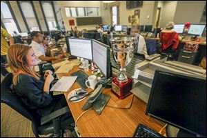 A monthly VIP trophy sits on the desk of Emily Krieger. The goal at U.S. Xpress, supervisors say, is to focus on the little things that make people enjoy coming to work.
