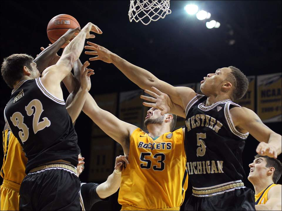 University of Toledo center Nathan Boothe (53) battles Western Michigan defenders Taylor Perry (32) and David Brown (5) for a rebound during a basketball game Saturday, 01/17/15, at Savage Arena in Toledo, Ohio.