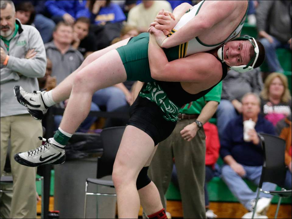 Delta wrestler Devon Richard lifts Tyler Koester of Clay High School during their 220-pound final match at the Maumee Bay Classic at Oregon Clay High School, Saturday, January 17,  2015.