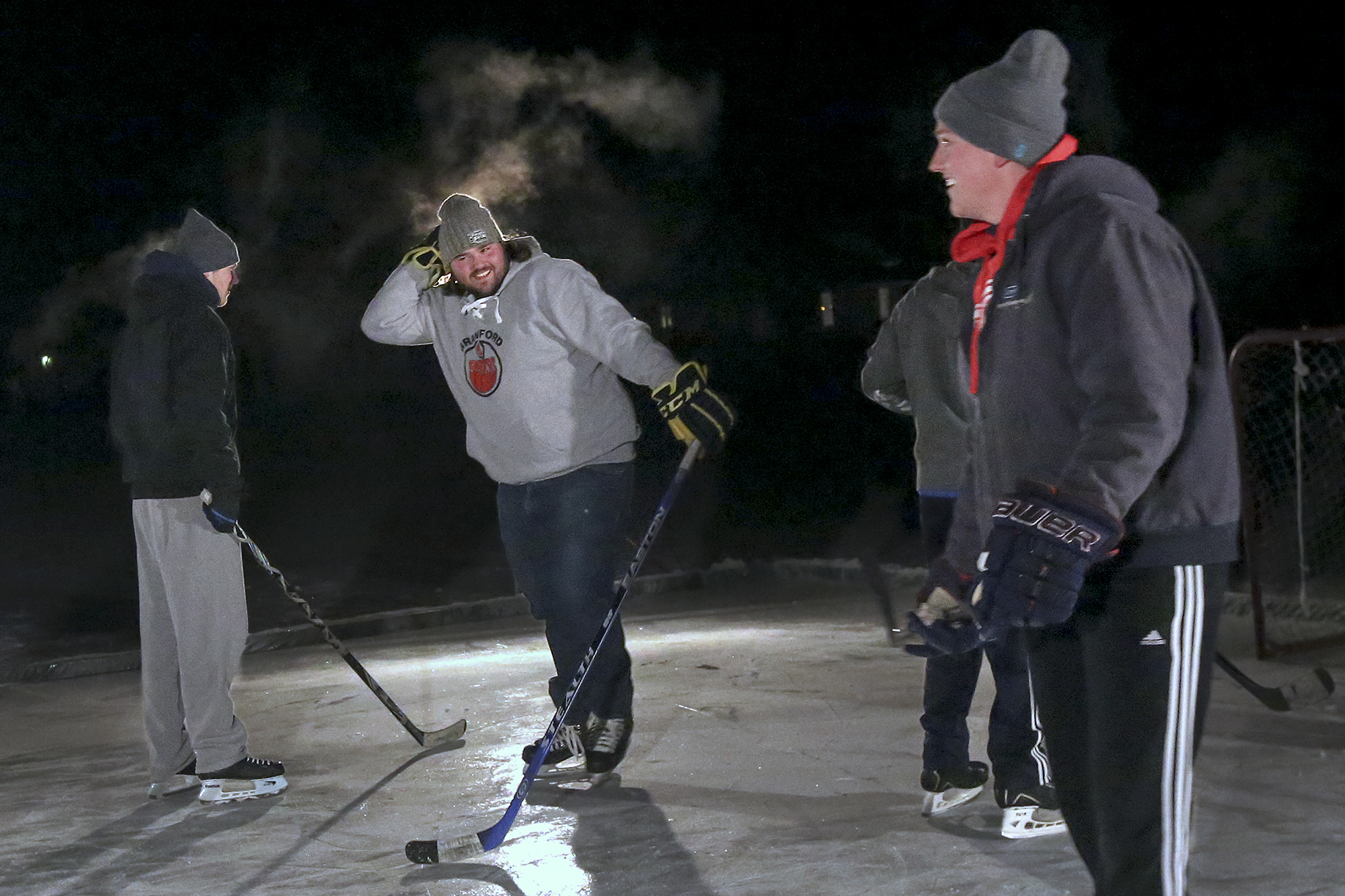 family extends winter tradition skates on own rink in backyard