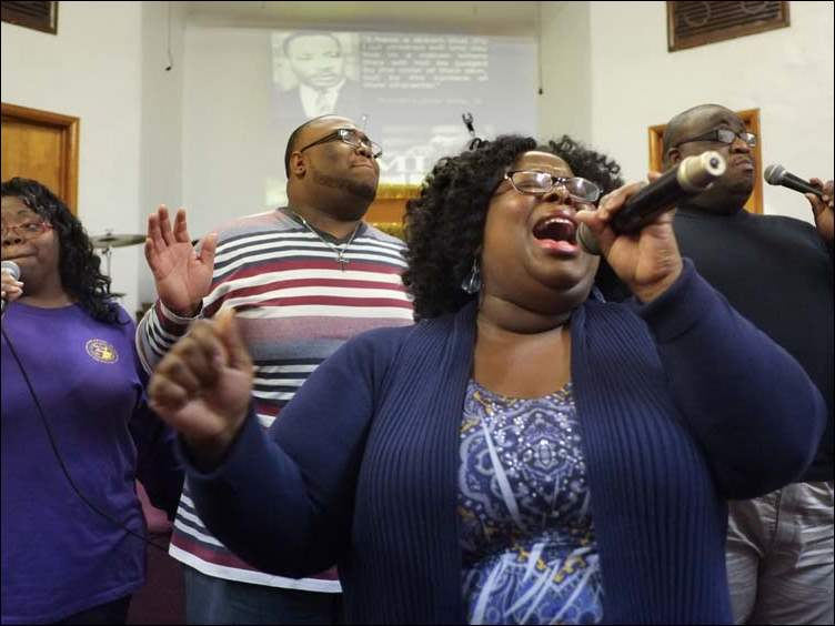 Members of the Lo Salem Baptist Church Praise Team, including, from left, Carole Gates, DeJuan Dixon, LaTonya Crawford, and Luther Mayfield, sing during the Martin Luther King, Jr., celebration.