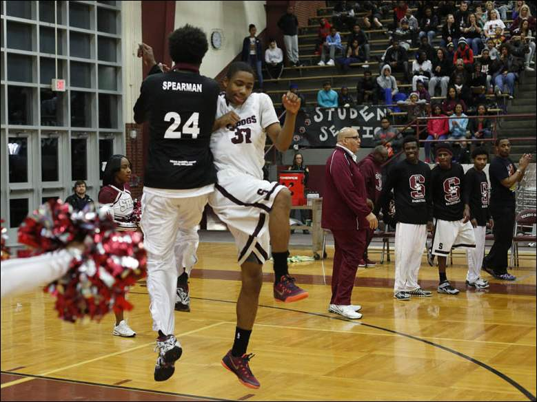 Scott's Damien Spearman greets starter Chris Darrington on the floor at the start of the MLK Classic game.