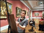 Guest artist Bradley Atherton gives a drawing demonstration  at the Toledo Museum of Art during a recent TMA Thursday.