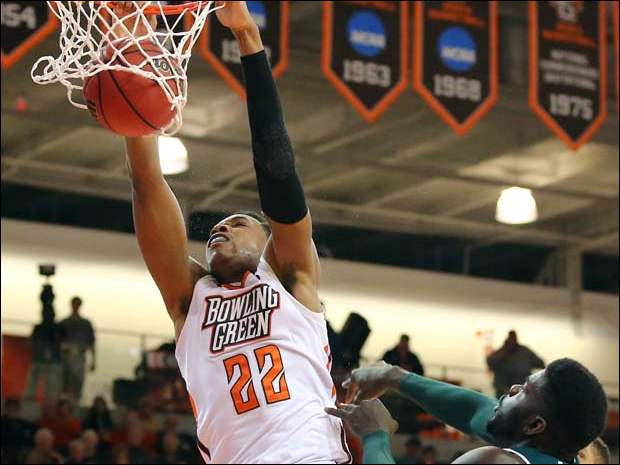 BGSU forward Richaun Holmes (22) dunks the ball against  Eastern Michigan forward Olalekan Ajayi (12).