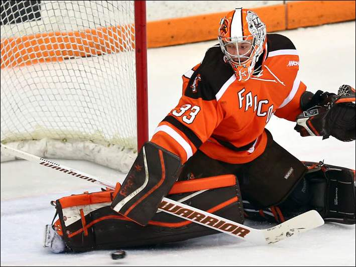 BGSU goalie Chris Nell (33) blocks a shot against Lake Superior State.