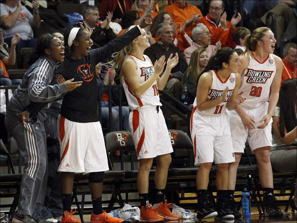 BGSU's bench gets up to celebrate a three pointer shot by Kennedy Kirkpatrick, not pictured,  during the first half of women's basketball against Miami University at The Stroh Center at BGSU on January 24, 2015.