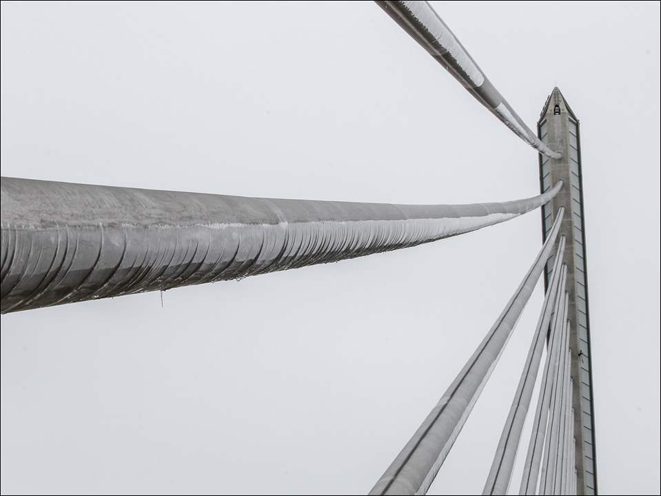 Sheets of ice are formed on the underside of support cables as northbound I-280 is closed due to ice on the Veteran's Glass City Skyway bridge cables, Friday, January 23, 2015.