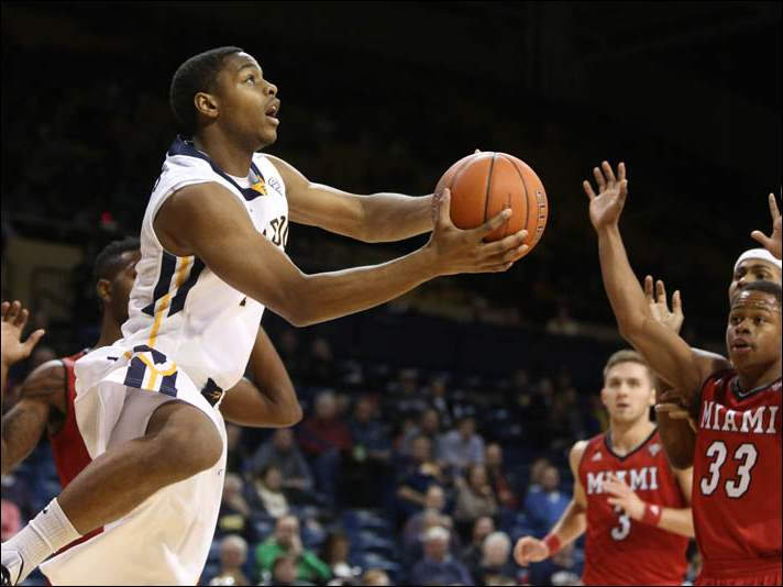 Toledo's Jonathan Williams (1) goes in for a layup.