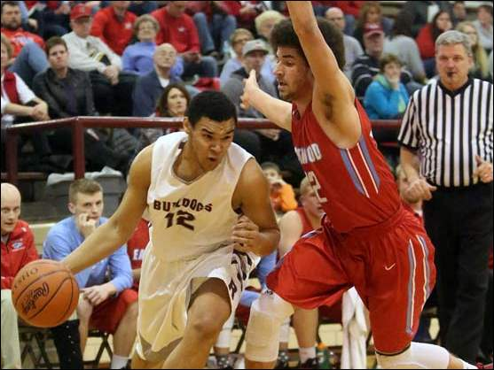 Rossford's Cota Sinclair (12) drives around Eastwood's Tim Hoodlebrink (12) during the second half.