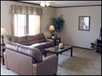 The comfortable living room welcomes you home. The floorplan is spacious atWoodcreek Village.