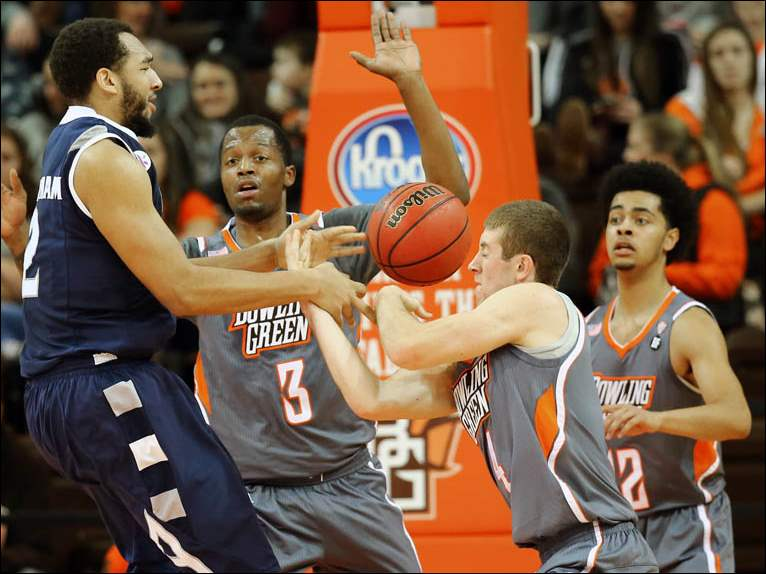 Bowling Green State University guard Zack Denny (4) steals the ball from  Akron forward Kwan Cheatham, Jr. (2).