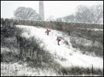 Sledders make their way up a hill outside of Fort Meigs in Perrysburg.