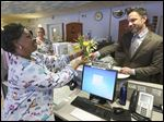 Todd Yerman, of the Hart advertising agency, deliver flowers to Deb Taylor, a nurse at ProMedica Toledo Children's Hospital. Looking on is  nurse Kim Rellinger, a patient care supervisor.