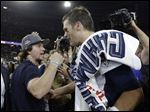 New England Patriots quarterback Tom Brady (12) celebrates with actor Mark Wahlberg after the NFL Super Bowl XLIX football game against the Seattle Seahawks on Sunday in Glendale, Ariz.=