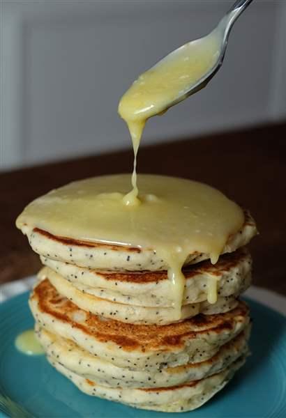 Lemon poppy seed pancakes with lemon curd sauce.